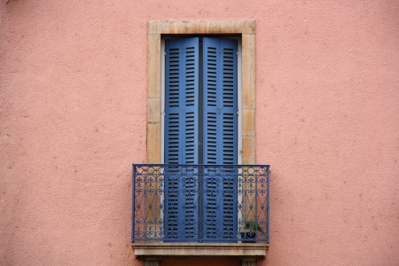 of old times: pink wall and blue balcony from old times