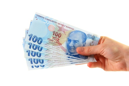 woman holding turkish lira on isolated white background photo