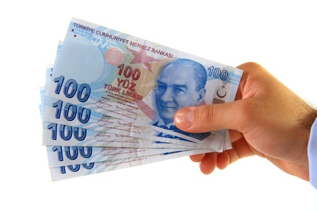 business man holding hundred turkish lira photo