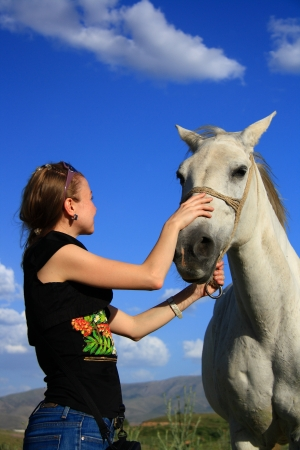 controling: veterinary woman controling horse health and examination