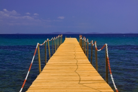 mabul: wooden peer on blue sea with blue sky