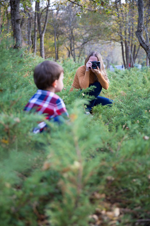 Mother taking Photo with her son in nature
