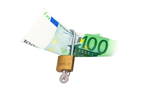 Euro under lock and key  isolated on the white backgrounde photo