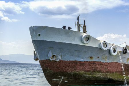 Old ship on a background of the mountains on the island photo