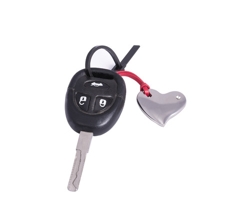keyless: the car key in the keychain in the shape of a heart on the white background