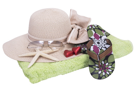beach set with plea glasses towel with white background photo