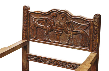 arranging chairs: woodcarving with picture of birds of the chair on the white background Stock Photo