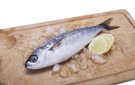 frozen fish: fish bogue with lemon on white background