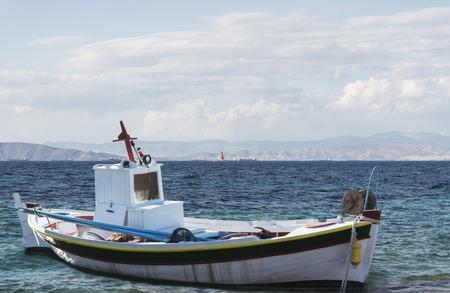 summer landscape sea and wooden greek boat