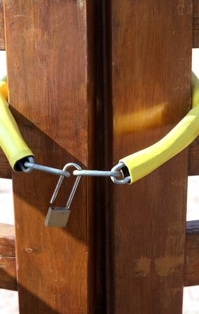 keep gate closed: metal open locks on a wooden door