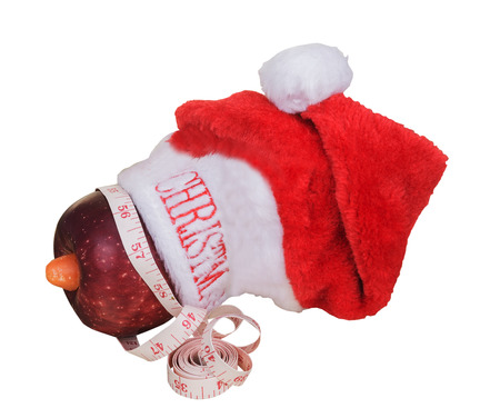 carrot tree: Christmas hat and apple with white background