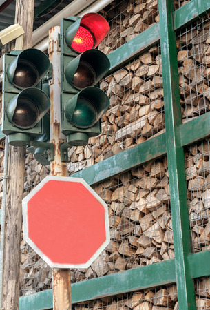 firewood stacked in the container and red light in the traffic Stock Photo
