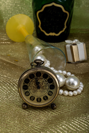Christmas card with clock, champagne and pearls