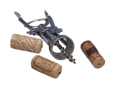 uncork: corkscrew and cork for wine isolated on a white background