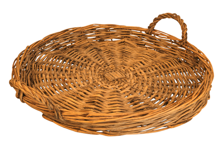 breadbasket: woven straw of bread or fruit isolated on white background Stock Photo