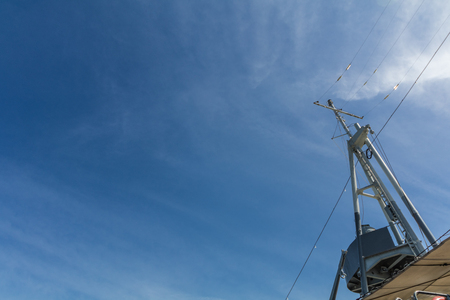 klong: Old cruiser ship communication tower with blue sky. Stock Photo
