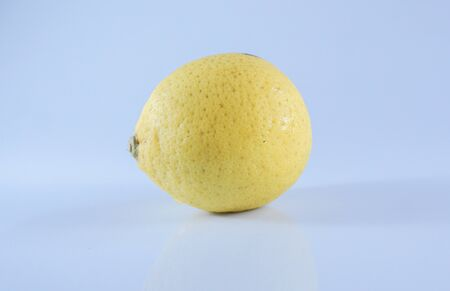 One lemon isolated on white background. Tropical fruit, Lemons are great for nutrition and body health.