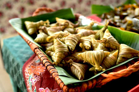 Lemang is a traditional malay food serving during Eid celebration. Lemang made of glutinous rice cooked inside a bamboo. Famous food in Malaysia.Soft, Blurry and contain noise. Stock Photo