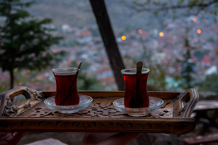 Drinking turkish tea after the long work day Stock Photo