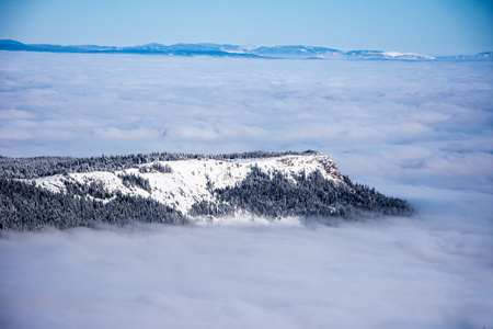 bosna and herzegovina: Mountain top and the forest covered in snow and mist on Jahorina, Bosnia and Herzegovina