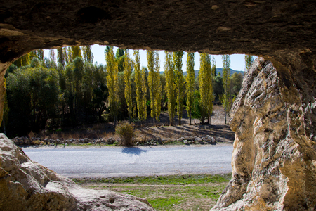 looking through the window from the cave in Phrygian Valley in Turkish city Afyon Stock Photo