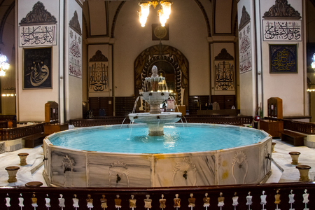fountaion place where muslims take a wudhu for praying inside of Grand mosque in Bursa, Turkey