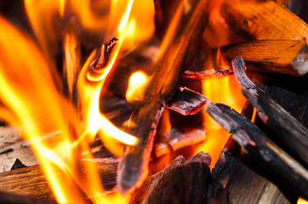 flame devouring wood sticks on a coasy fireplace in a hous Banco de Imagens