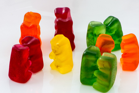 closeup shoot of the  color pairs of gummy bears and one lonely bear Stock Photo