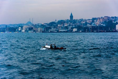 taking picture of the Galata Tower from the sea while driving on the boat Stock Photo
