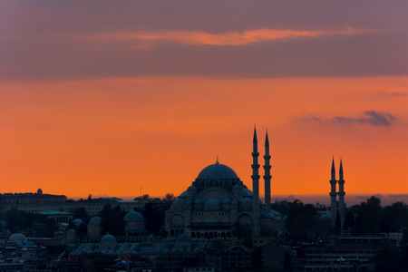 Istanbul cityscape with a famous Suleymaniye mosque at sunset Stock Photo