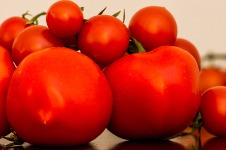 The bunch of tomatoes on the kitchen table ready for preparing the salat Stock Photo