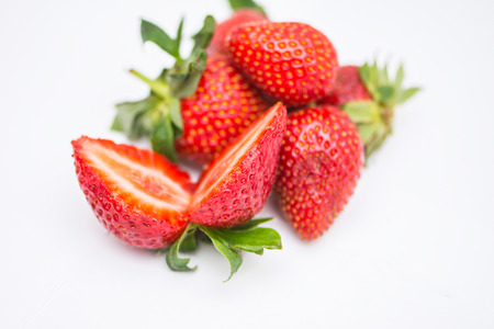 The two halfs of the ripe strawberry on the white background.