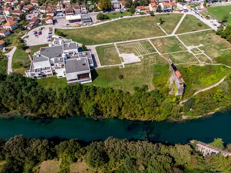 Drone view to the destroyed railway bridge in river Neretva and historical museum in city of Jablanica, Bosnia Imagens