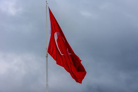 Turkish flag waving in the sky during the windy and rainy day