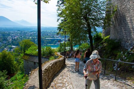 Tourists climbing to the Castle on Lake Bled in Slovenia on 27 July 2019 on the suny day