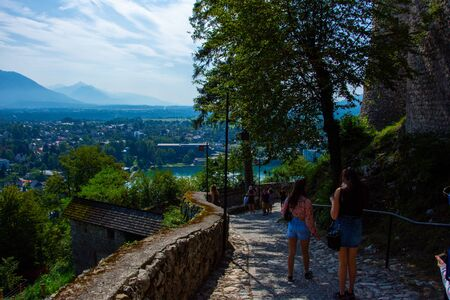 Tourists climbing to the Castle on Lake Bled in Slovenia on 27 July 2019 on the suny days Redactioneel