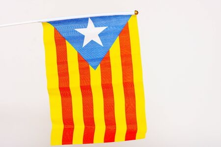 catalonia flag held on the white background isolated
