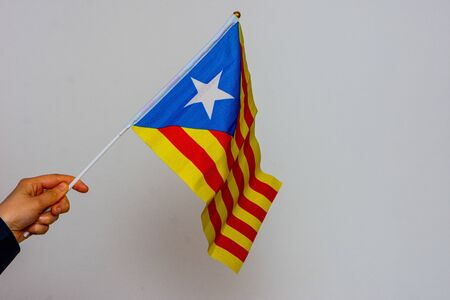 catalonia flag held on the white background isolated Foto de archivo