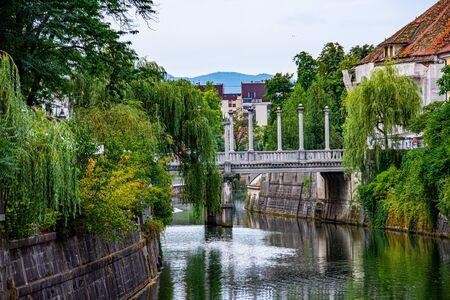 View to the bridge ove the river Ljubljanica in city of Ljubljana in Slovenia
