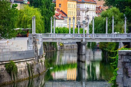 Beautiful view to bridge on the river Ljubljanica in Ljubljana in Slovenia