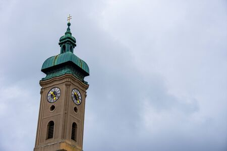 Beautiful church tower with green roof top
