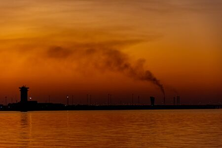 Amazing and colorful sunset above Shuwaikh beach