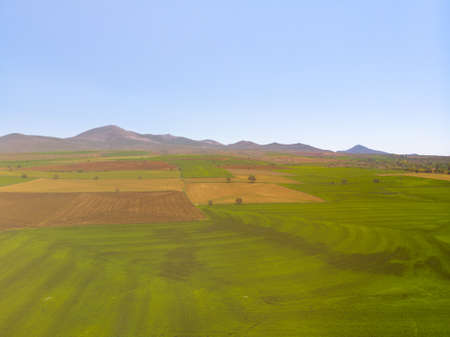 Aerial view to the fertile and arable fields
