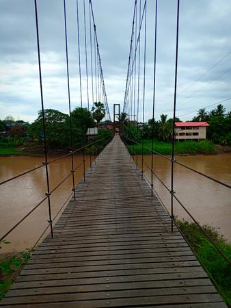 Suspension bridge across river.