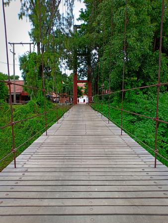 Suspention bridge across river.