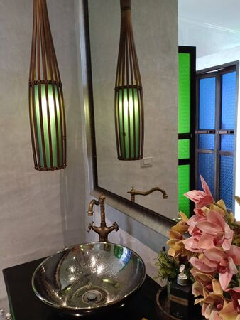 Sukhothai, Thailand, July 25th, 2018, Green lantern in toilet. Éditoriale