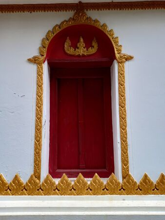Sukhothai, Thailand, July 30th, 2018, Thai design chapel window.