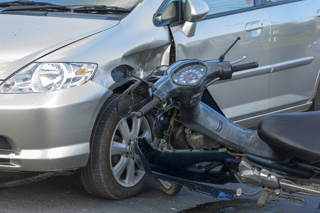 traffic accidents: Motorcycle accident with a car  Editorial