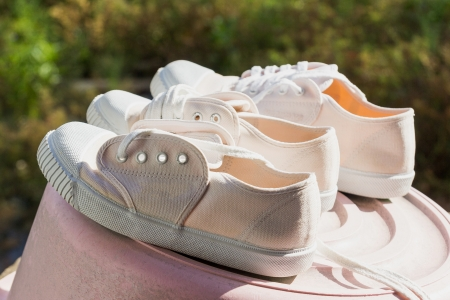 dry cleaning: Shoes, white students were to dry cleaning  Stock Photo