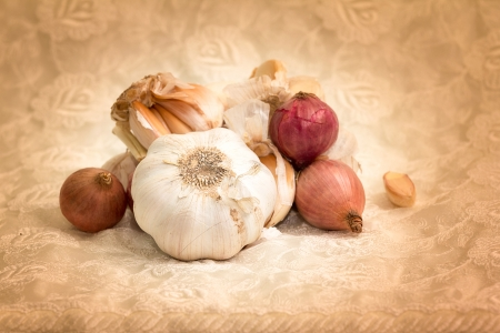 Onions and garlic on a tablecloth  photo